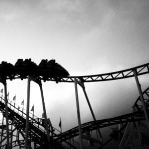 Grayscale photo of roller coaster